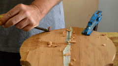 Luthier working with a chisel in workplace Stock Footage