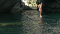 Cliff diving splash slow motion Stock Footage