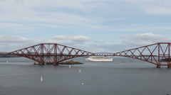 Yachts, cruise ship and Forth Rail Bridge Scotland Stock Footage
