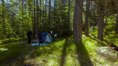 Camping timelapse, couple camping in the woods, morning sun 4K 30p Stock Footage