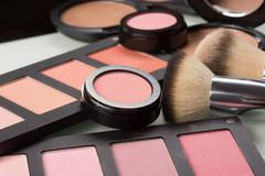 Makeup cosmetics. compact powder, mineral foundation and makeup brushes Stock Photos