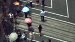 Crowds of people rushing around on Silom Road Stock Footage