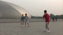Young Chinese tourists, Beijing, China Stock Footage