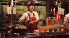 Chinese jiaozi dumplings in street market - stock footage