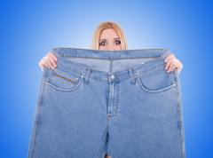 Stock Photo of Dieting concept with oversize jeans