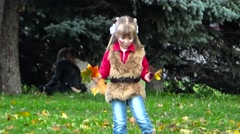 Littl girl collects maple leaves. Perm. Russia. September 2015. Stock Footage