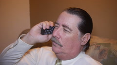 MAN TALKING on old analog telephone cell phone - stock footage