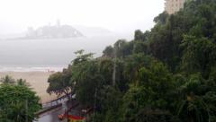 Rain on the beach with trees, nature, street and island on the back Stock Footage