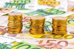 Three stacks of money coins Stock Photos