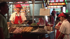 Street food kebabs, Chinese market, Beijing Stock Footage