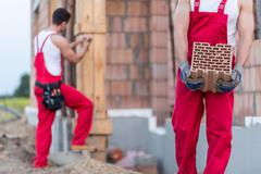 Worker building masonry - stock photo