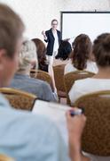 Man taking notes during symposium Stock Photos