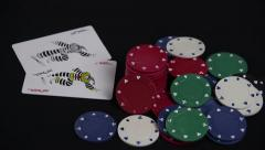 Closeup of Poker Chips and Playing Cards on Black Stock Footage
