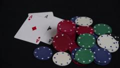 Stock Video Footage of Three Aces Falling on Table Next to Poker Chips