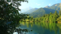 Summer lake under mountains Stock Footage