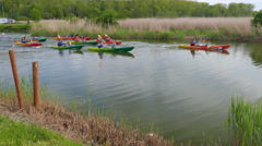 Adults with children kayak race. Kayaking in nature - stock footage