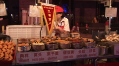 Chinese cake stall, Beijing food market Stock Footage