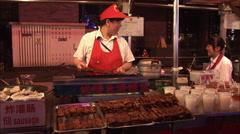 Roast eel, Chinese street food market Stock Footage