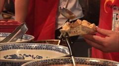 Serving Chinese tofu and sauce, Beijing Stock Footage