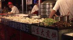 Goubuli dim sum, Chinese street food market Stock Footage