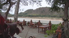 Tables near the river in Luang Prabang, Laos Stock Footage