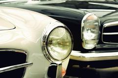 Headlights old cars in vintage style(Genesis, antithesis, evolution, couple, - stock photo