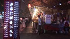 Wangfujing night market, Beijing, China Stock Footage