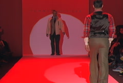 Male fashion models walking on runway for Tommy Hilfiger Collection Stock Footage