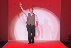 Tommy Hilfiger being appreciated by guests during Fall 2002 fashion show Stock Footage