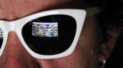 Man in glasses surfing internet on laptop Stock Footage