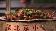 Cooked meat, Beijing food market, China Stock Footage