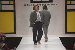 Male fashion models walking on runway for Wilke Rodriguez Collection Stock Footage