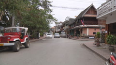Cars on the street in Luang Prabang, Laos Stock Footage