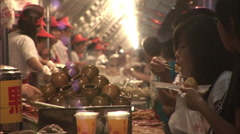Buying street food in Chinese market Stock Footage