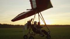 Moving Motorized Deltaplane at Sunset Stock Footage