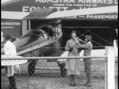 1930s Woman Pilot Boards Airplane/ Takes Off Stock Footage