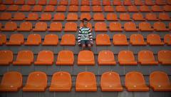 Fan boy depressed so that the team conceded a goal at the stadium frustrated boy Stock Footage