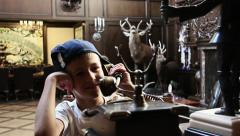 Boy talking on the old phone, teenager in the house takes the old phone and said Stock Footage