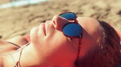 Girl sunbathing on the beach on towel - stock footage