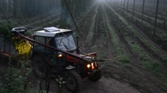 Tractor carrying hops to harvester Stock Footage