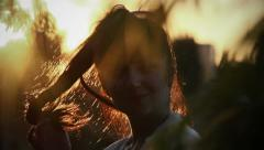 Sexy woman flirting on camera, lures at sunset, girl playing with hair at dawn Stock Footage
