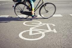 Cyclist on the cycle lane - blurred motion - stock photo