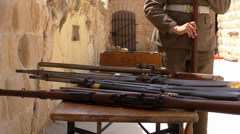 Stock Video Footage of Soldier checking old rifles