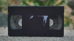 Smashing smash VHS video tape Stock Footage