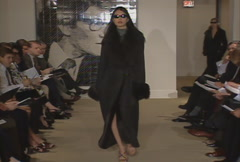 Fashion models walking on runway for Yves Saint Laurent Fur Collection Stock Footage