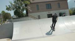 A boy landed a backward kickflip Stock Footage