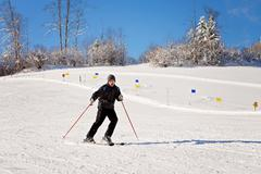 Portrait of young man, skiing in mountain winter resort Kuvituskuvat