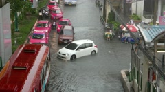 Car and bus crowd at flooding street, heavy rain in Bangkok, timelapse Stock Footage