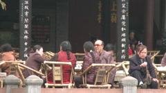 Chinese people in teahouse, Chengdu, China Stock Footage