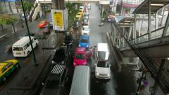 Thai family come out from taxi, rainfall flood on driveway traffic jam TIMELAPSE Stock Footage